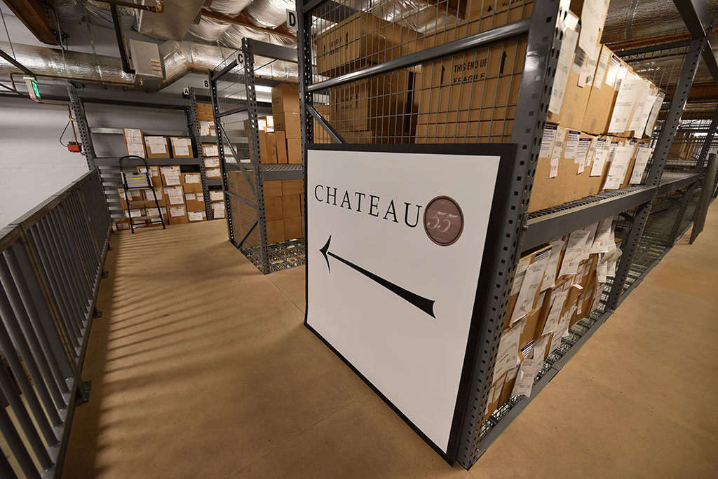 Chateau 55 Sign in Warehouse Storing Cases of Wine